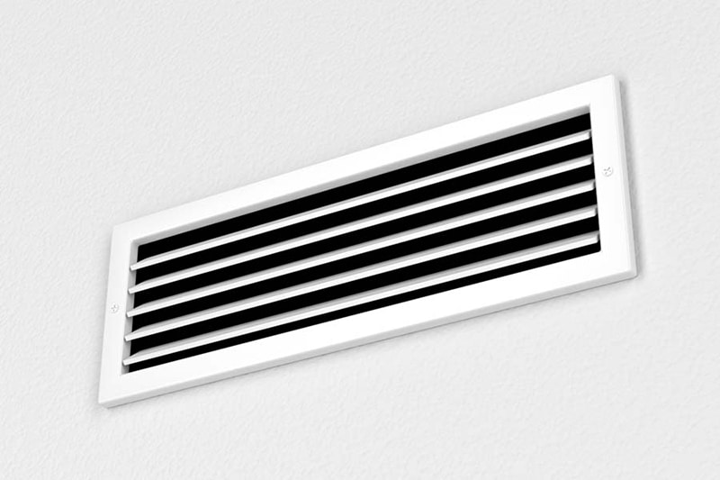 White AC vent on wall